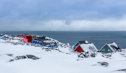 Colorful inuit houses and streets among the stones  in a suburb of arctic capital Nuuk