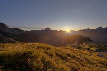 Sunrise with ridge and bivouac tent, Hinterhornbach, Lechtal, Ausserfern, Tyrol, Austria, Europe