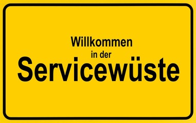 Town sign, German lettering Willkommen in der Servicewueste, symbolic of lack of service