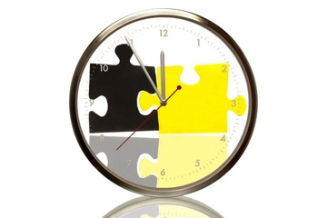 Clock with black and yellow pieces of a puzzle, 5 minutes to twelve, eleventh hour, symbolic image for the German governing coalition