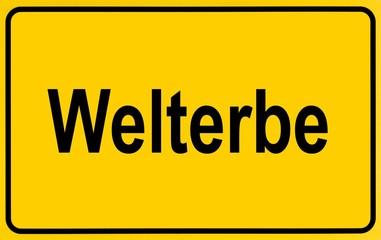 Place-name sign as a symbol for entering a Weltkulturerbe, German for: World Heritage Site