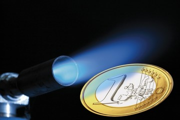 Gas flame and euro coin