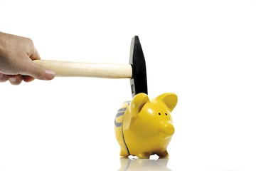 Hammer and a yellow piggy bank