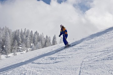 Skier on a slope with helmet