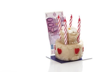 Mini marzipan birthday cake with a little 500 euro note
