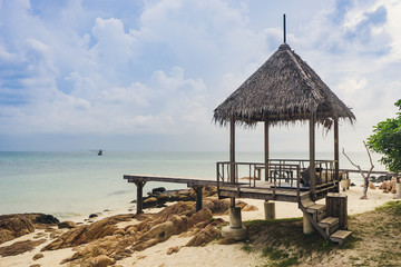 The cottage and wooden pathway with beautiful island in Rayong , Thailand.