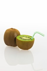 Kiwi fruits, kiwi fruit with a drinking straw as a soft drink
