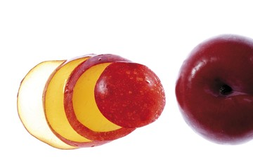 Red plum slices and plum