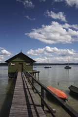 Boat house with wooden jetty on Ammersee Lake, near Schondorf, Upper Bavaria, Germany, Europe