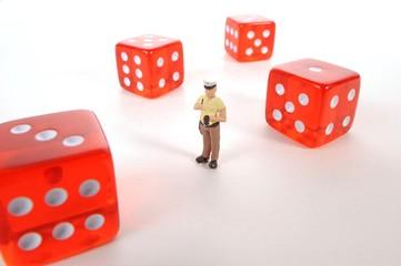 Policeman miniature between cubes, symbolic image illegal gambling