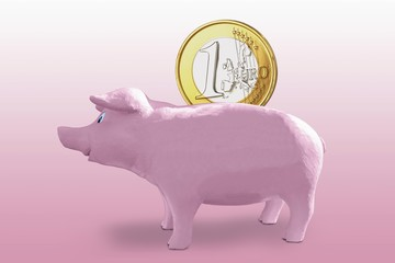 Large one euro coin in a pink piggy bank, symbolic image