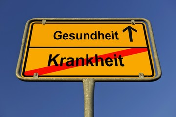 City limit sign, symbolic image for the way from Krankheit to Gesundheit, German for going from being sick to regaining health