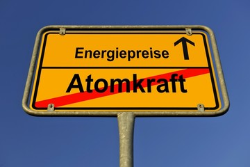 City limits sign with the words Energiepreise and Atomkraft, German for energy costs and nuclear energy, symbolic image for the exit from nuclear energy resulting in rising energy costs