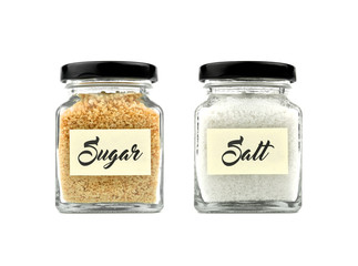 Brown sugar and salt set in a glass bottle isolated on white background, with word on yellow stick note paper and black lid. Modern and stylish. Close up.