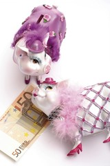 Piggy banks, dressed up, with 50 euro banknote