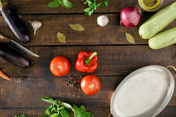 Different vegetables on a wooden table, top view