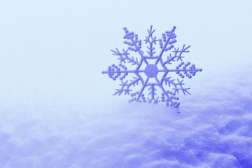 Decorative snowflake in snow