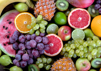 Wall Mural - Fruits background. Healthy eating concept. Top view.