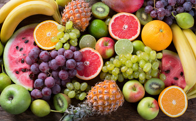 Zelfklevend Fotobehang Vruchten Organic fruits background. Healthy eating concept. Flat lay.