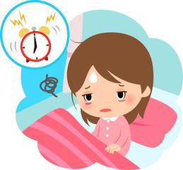 疲れた表情で起床する女性