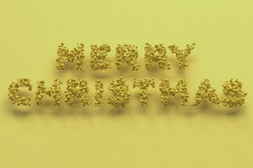Merry Christmas words from yellow balls on yellow background