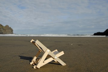 Deckchair on the Pihabeach, New Zealand, symbolic picture for holidays, Oceania