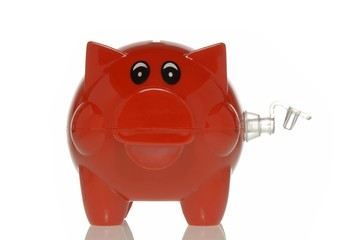 Piggy bank with an open valve, symbolic image for banks running out of air