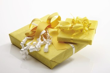 Gift box with a yellow ribbons