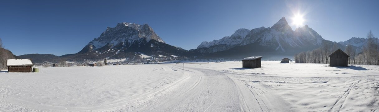 View from Lermoos towards Zugspitze and Sonnenspitze mountains and the small town of Ehrwald, Tyrol, Austria, Europe