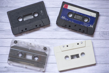 Old cassette tapes with a wooden background