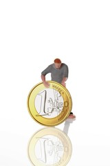 Figure of a worker with a Euro coin