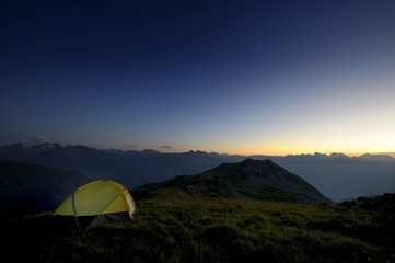 Tent in front of a mountain range in the last daylight, Gaschurn, Montafon, Vorarlberg, Austria, Europe