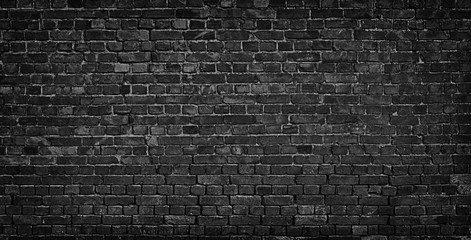 dark brick wall as a backdrop. brickwork design element