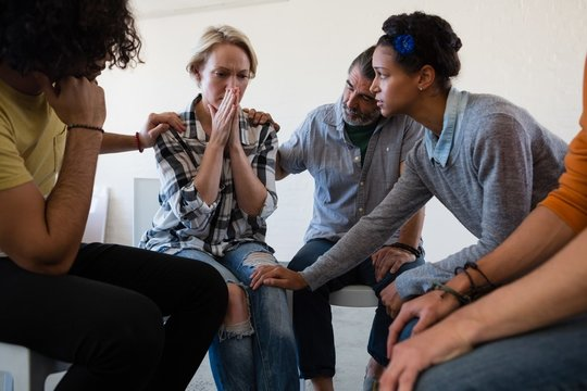 Friends consoling worried woman