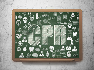 Health concept: CPR on School board background