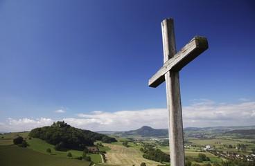 Cross, view of Maegdeberg volcanic mountain, Hegau, Baden-Wuerttemberg, Germany, Europe