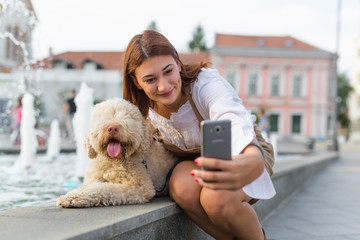 Say cheese !!! Woman taking selfie with her dog outdoor