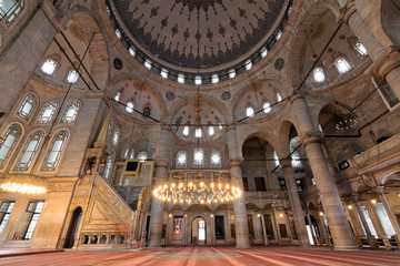 Interior low angle shot of Eyup Sultan Mosque situated in the Eyup district of Istanbul, Turkey, outside the city walls near the Golden Horn. The present building dates from the beginning of the 19th