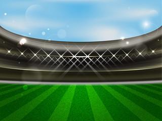 Soccer field. Football stadium. Sport arena with tribune, spotlights, blue sky and green grass.