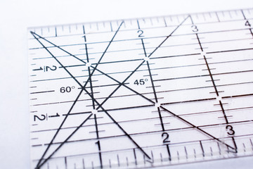 Selective focus on a quilting ruler showing the angle markings