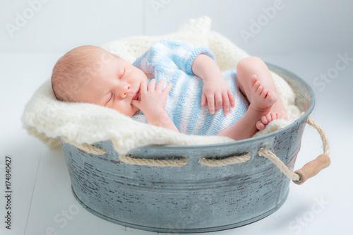0594de0d7 Lovely newborn baby sleeping in little bath