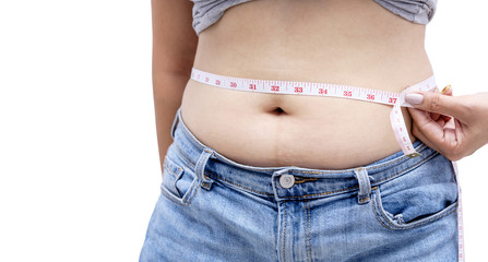 Woman measuring her waistline fat tummy isolated on white background with clipping path. ,obese women,Body part of a fat woman with measuring tape