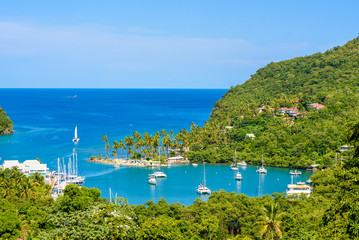 Marigot Bay, Saint Lucia, Caribbean. Tropical bay and beach in exotic and paradise landscape scenery. Marigot Bay is located on the west coast of the Caribbean island of St Lucia. Fotomurales