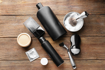 Personal care products for men on wooden background