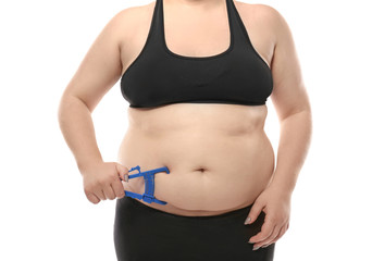 Overweight woman with measuring caliper on white background. Weight loss concept