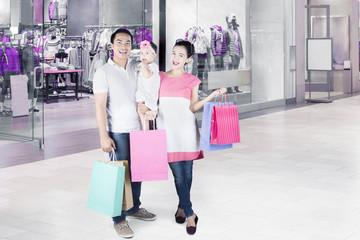 Family standing in shopping center