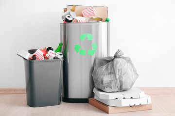 Litter bins and bag with garbage indoors