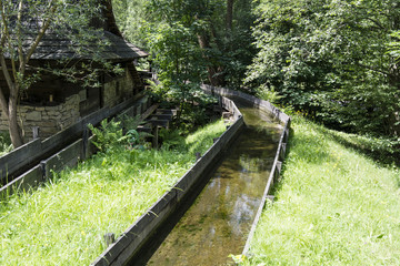 The wooden water canal at the mill.