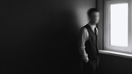 Black and white of young man with blurred face