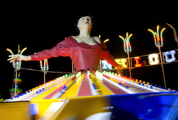 ballerina at amusement park by night